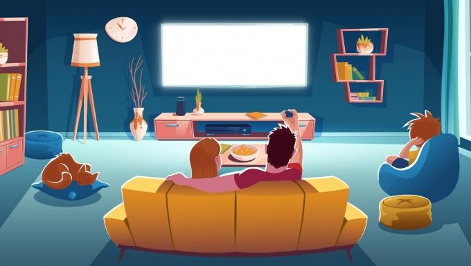 Une famille devant un écran.