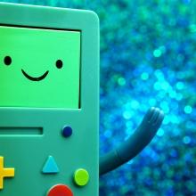 Console de jeu portable personnifiée qui salue de la main gauche