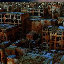 Ville en ruine vue du dessus. Les immeubles et structures sont sales et rouillées
